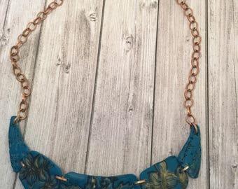 Copper leaves blue bib
