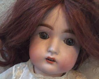 Antique Franz Schmidt German bisque head doll with composition body