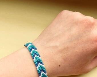 Shevron bracelet plus button closure