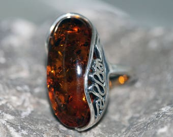 Baltic Amber Ring. Cognac Baltic Amber fitted in sterling silver setting. Handmade & unique. Ring is adjustable.