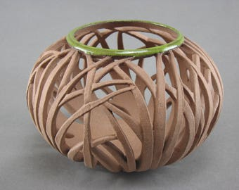 Carved clay vessel