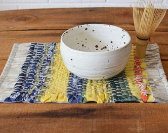 Woven mug rug, snack mat, placemat, table decoration. Hand woven. November Maximum Yellow Blue Green