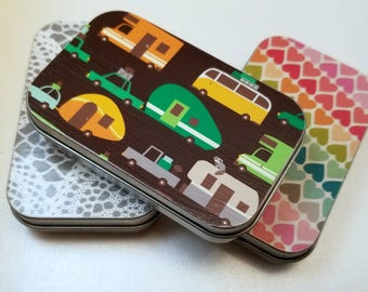 Large tin trio . . . Vintage trailers, crochet doily, and rainbow hearts. Great for knitting notions.