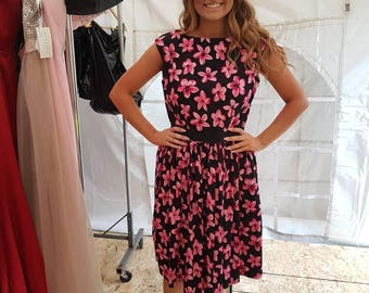 Black and Pink floral boat neck style dress with gathered skirt and button detail