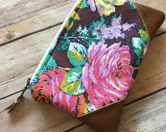 Zippered pouch with leather accents