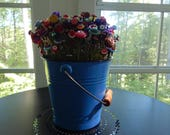 Button Bouquet in a large blue bucket