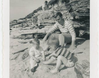 vintage photo 1950s Stripes for all Dad at beach with his little boys in the sand