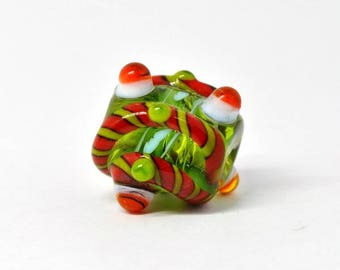 Museum style green, red, white barrel bead