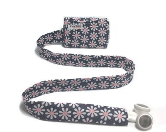Gray and pink daisy TuneTube.  Earbud cord organizer for iPhone or iPod.  Cord keeper.  Earbud holder.  Earbud case.