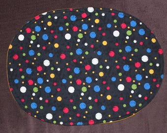 Oval placemats with multi colored polaka dots on black, set of 4