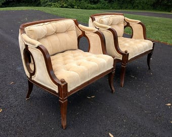 2 HOLLYWOOD REGENCY curved barrel lounge chairs