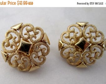 ON SALE- vintage mid century modern gold tone textured filigree clip on earrings signed Avon hallmark - j6145