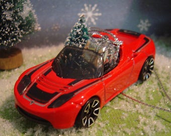 2008 Tesla Roadster  car with Christmas tree ornament