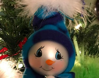 Hand Painted Snowman/lady/baby Ornament with fleece hat.