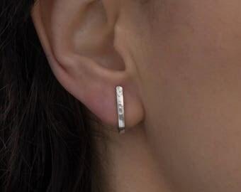 Stud earrings, hammered J wrap studs, shiny