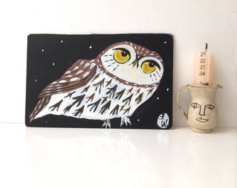 Painting on reused canvas board book cover of a little owl
