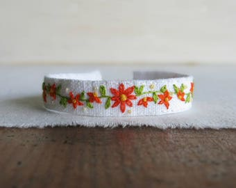 Orange Daisy Fabric Cuff Bracelet - Orange Flowers and a Green Vine on White Linen Cuff Bracelet