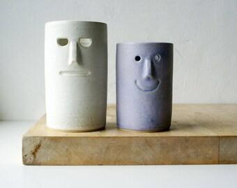 Ceramic pair of vases with face design - glazed in vanilla cream and lavender blue