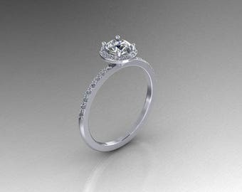 Elegant sterling silver half carat round cubic zerconia halo engagement ring .