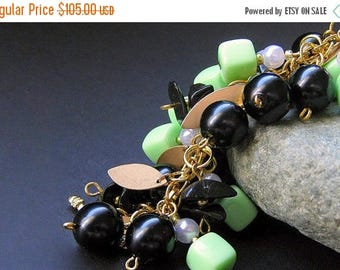 BACK to SCHOOL SALE Spring Green Charm Bracelet Beaded in Vintage Beads, Black Glass and Gold - Triumphant. Handmade Jewelry by Gilliauna