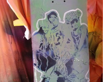 TLC street art painting on skateboard deck skate art music group original stencil and spray paint art by Rainbow Alternative