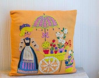 Vintage Throw Pillow, Retro Folk Art Dutch Girl, Crewel  Needlework, Bright Orange Flower Cart