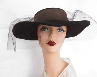 Woman's black hat, vintage 1970s Mr. John. New Old Stock, New York Paris