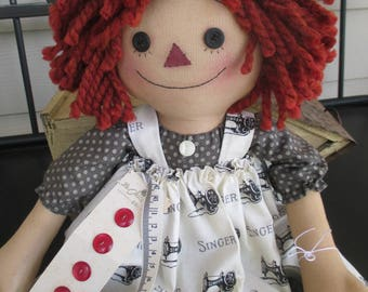 Primitive Annie with loves to sew with her apron and buttons