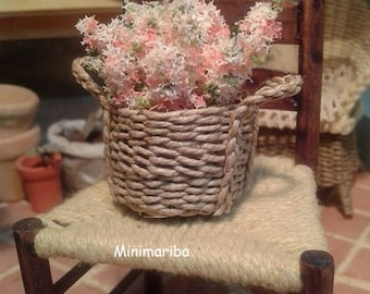 Miniture dollhouse woven basket with pink flowers