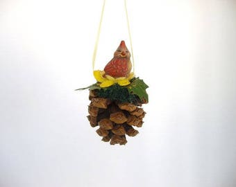 Ornament, pine cone ornament, decorated miniature pine cone with ceramic baby cardinal