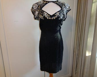Vintage LITTLE BLACK DRESS with hand sewn silver ,white and black sequins and seed beads in a floral design on a black silk background