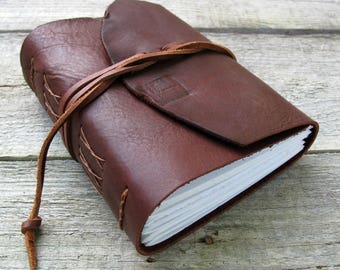 """Leather journal, Charles Dickens quote, """"Whether I shall turn out to be the hero of my own life"""" David Copperfield, 320 pages"""