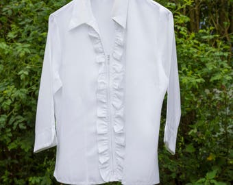 vintage unworn blouse 1960's style,ruffle/frill detail to neck and front.