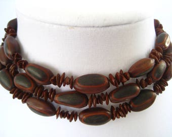 """43"""" Apple Seed and Larger Seed Necklace.  Natural Brown Color.  Larger Seeds have Color Pattern of Dark, Medium, and Mahogany Browns."""
