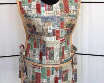 Tim Holtz Correspondence Transportation Tickets Cobbler Smock Style Cotton Apron with light brown trim - two pockets