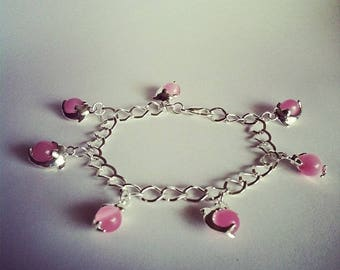 Dolphins charm bracelet pink glass beads