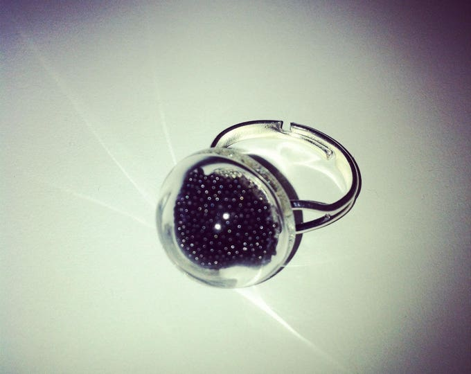 Ring round domed glass with black microbeads