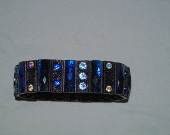 Blue metal and plastic cuff bracelet with blue and aurora borealis  plastic stones