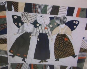 Wall-hanging pattern using scraps, called Scrap Bag Angels, by Betty Alderman