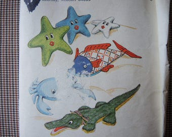 Vintage 1980s Kwik Sew sewing pattern 1217 learning toy snake,  puppets, puppet curtain, and baby ball UNCUT