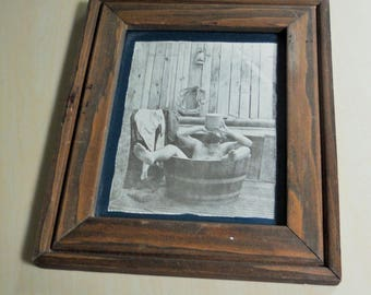 Old Man taking Bath, Moonshine jug,  Wood Frame,