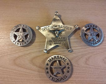 FOUR (4)  TEXAS BADGES