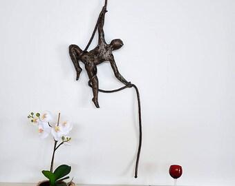 Metal sculpture, Acrobat sculpture,  male sculpture, interior design, Acrobat on aerial rope