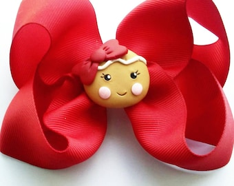 Gingerbread girl in red hair bow, Xmas bow, red bow