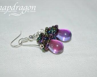 Purple iris seed bead topped briolette earrings.