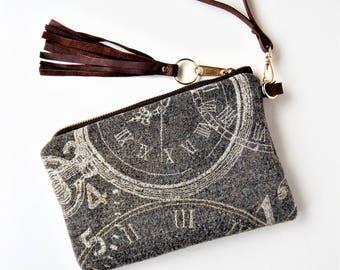 Gray wristlet, time traveler wristlet or clutch.