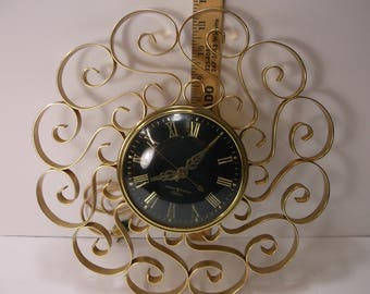 Wall Clock Retro Mid Century Gold And Black General Electric Living room Wall Clock . epsteam