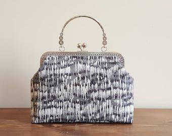 Black/grey lines kisslock frame bag with handle / crossbody bag