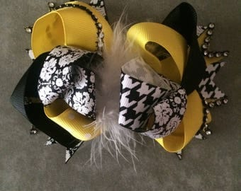 Black and yellow loopy bow