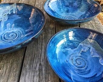 Set of nesting bowls, bright blue bowls